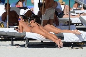 Bikini thongs, two girls at beach