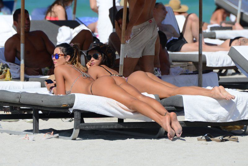Bikini thongs, two gilrs at beach