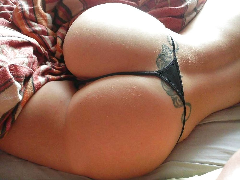 Perfect tattoo ass in thong
