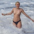 Miley Cyrus Tattoo Topless  at the Beach Hawaii