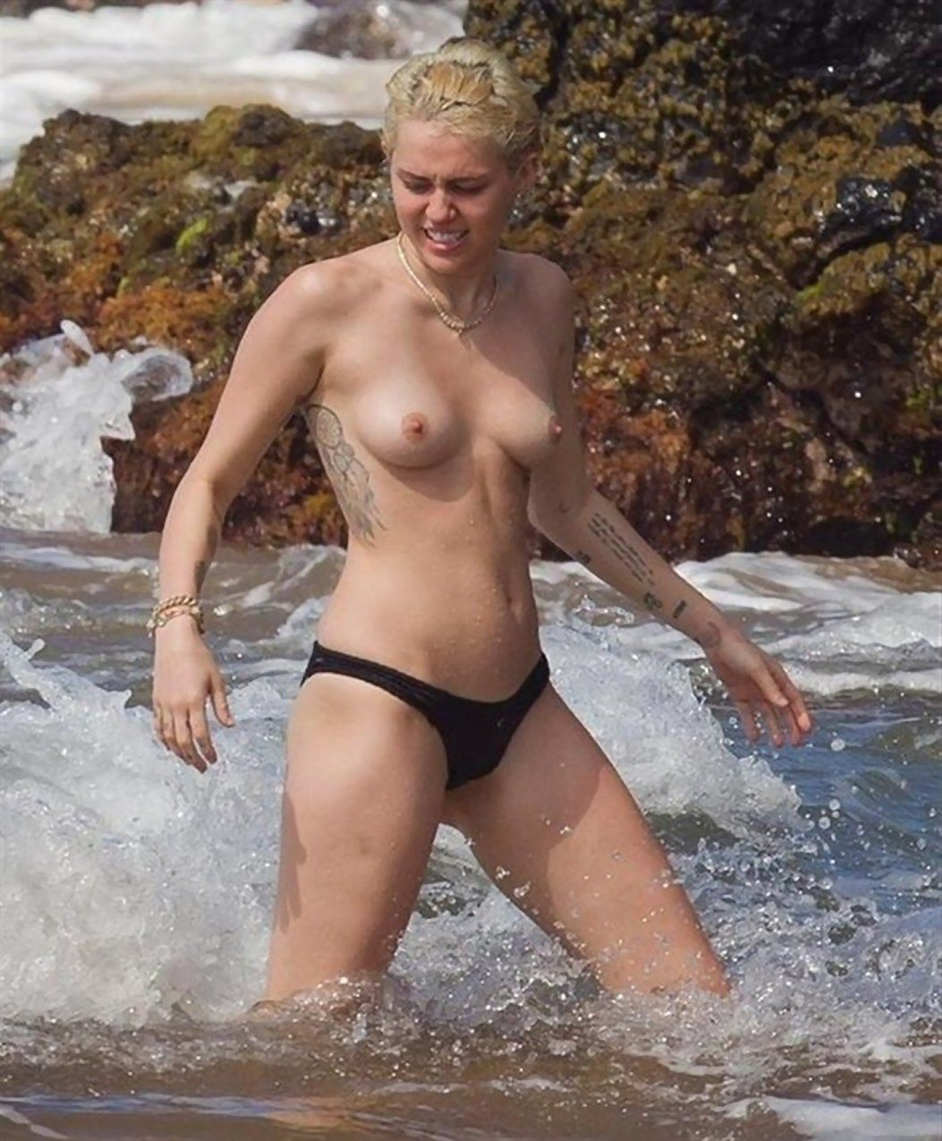 Miley Cyrus Tattoos and Topless at the Beach In Hawaii