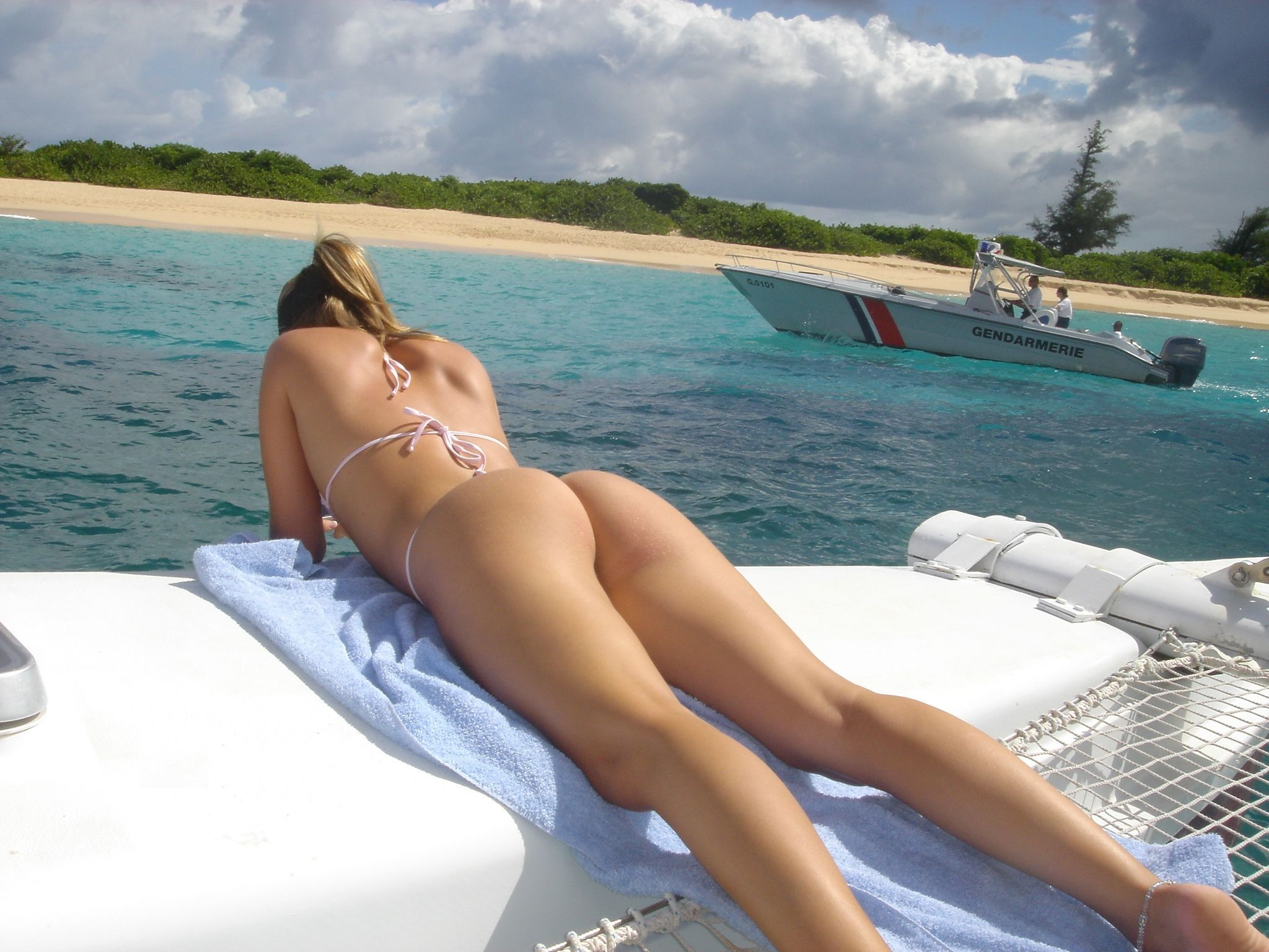 Sexy ass under sun. Micro bikini