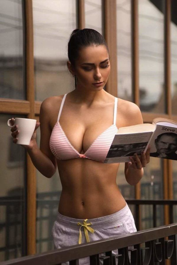 Perfect boobs, sexy reading Steve Jobs biography