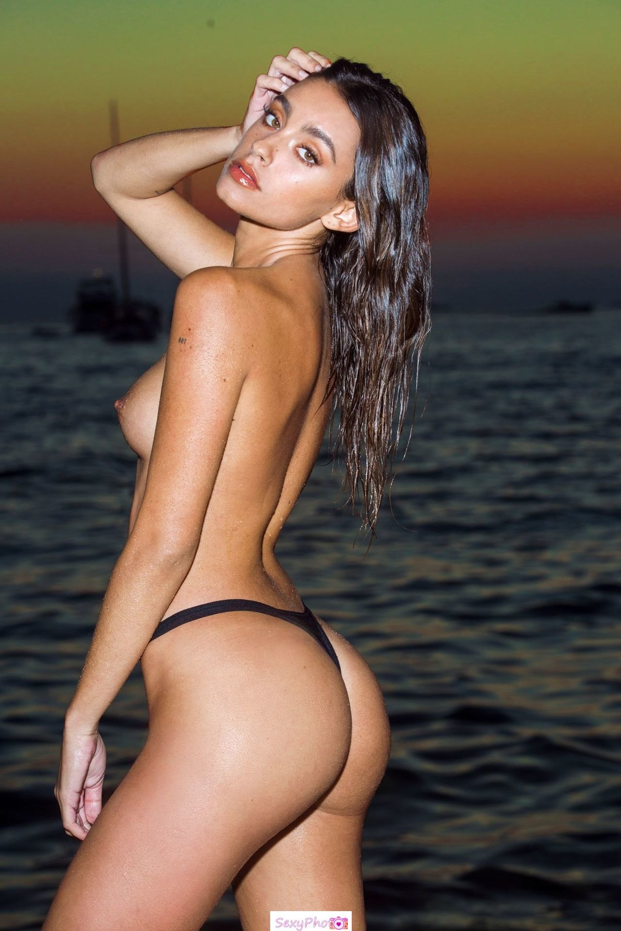 Carla Guetta posing topless