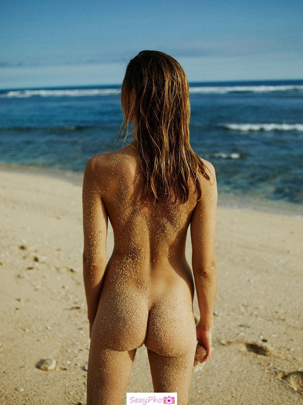 Julija Steponaviciute nude ass on a beach
