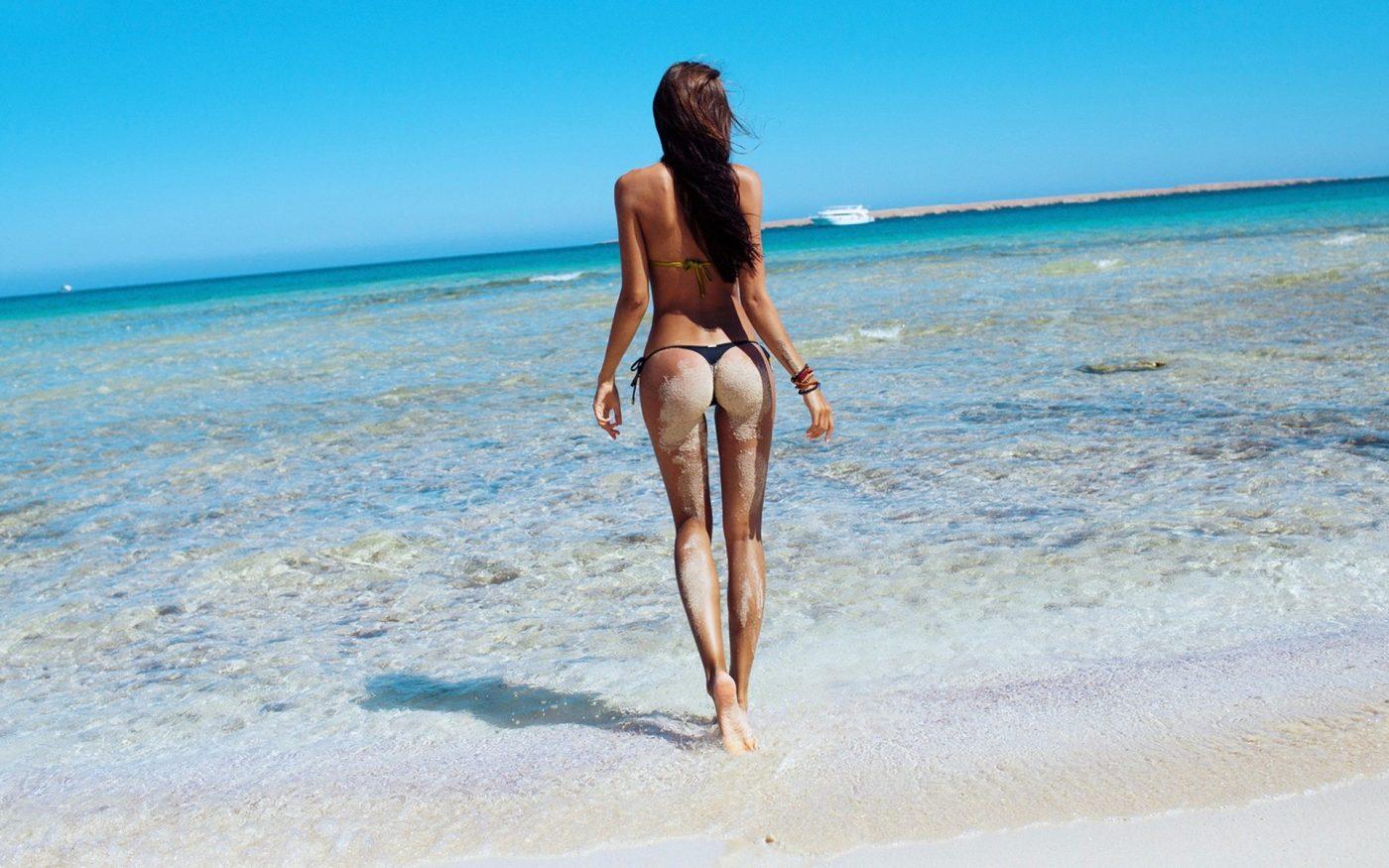women-model-sea-long-hair-shore-sand