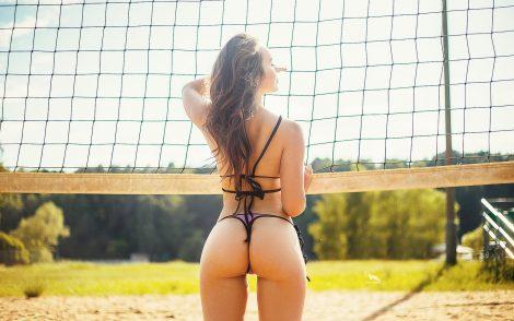 women-brunette-purple-bikini-beach-volleyball-sand-ass-