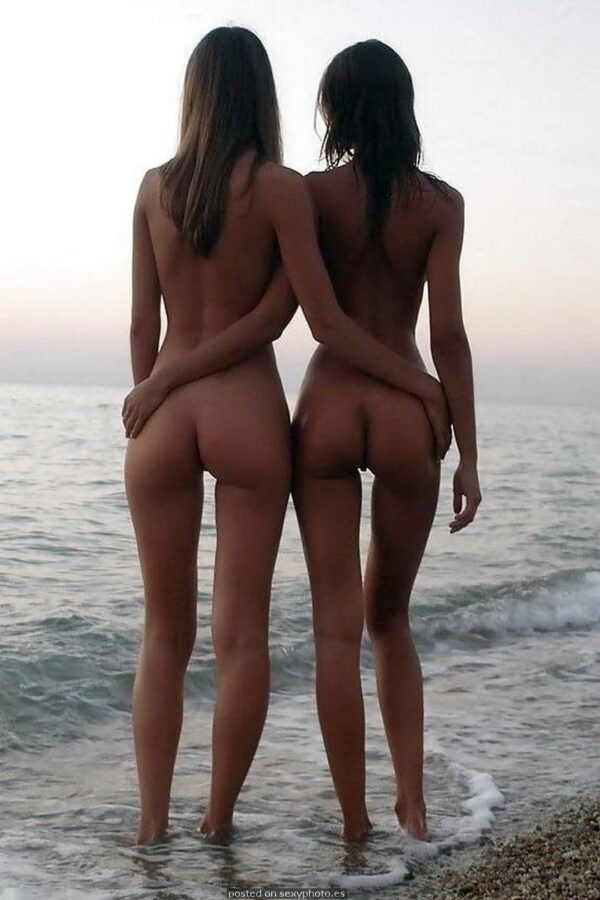 two nude teens at beach